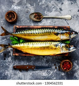 Appetizing smoked fish on kitchen board.Smoked mackerel