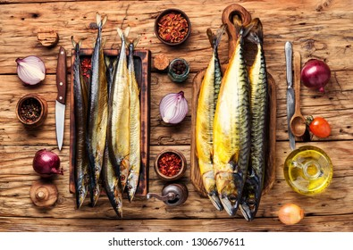 Appetizing smoked fish on kitchen board.Smoked mackerel.Smoked fish with spices