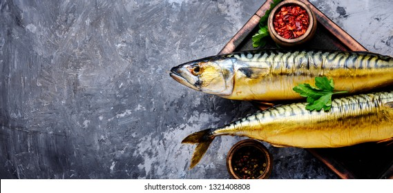 Appetizing smoked fish on kitchen board.Smoked mackerel.Mediterranean food