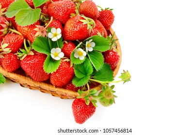 Appetizing strawberries in a wicker basket isolated on white background. Flat lay,top view. Free space for text.