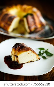 appetizing sweet cottage cheese casserole on a wooden table