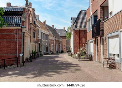 APPINGEDAM, THE NETHERLANDS - June 24, 2019: Little Venice of the North, Cityscape with architecture features traditional houses, A small and peaceful village located on the north of Groningen.