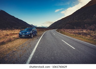 APPIRING NATIONAL PARK NEWZEALAND - SEP4,2015:suv car parking beside country road in traveling route of aspiring national park in west coast of southland new zealand