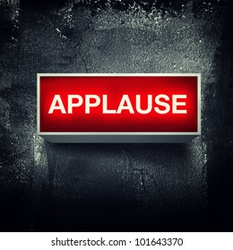 Applause warning board message is lit on.