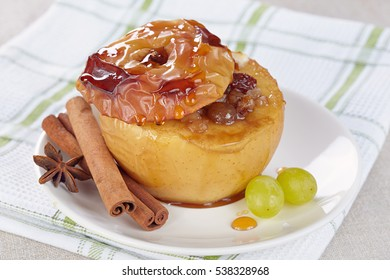 Apple baked with honey, nuts and raisins