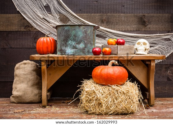 Apple bobbing station in an old fashioned barn Halloween party.