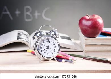 apple book and blackboard