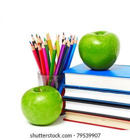 apple, books and colored pencil, back to school concept
