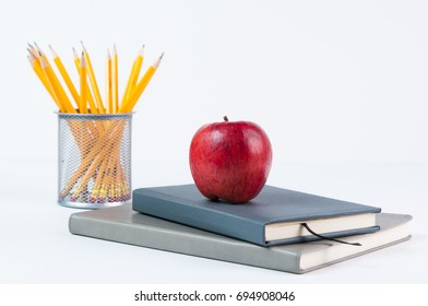 apple, books, and pencils for back to school