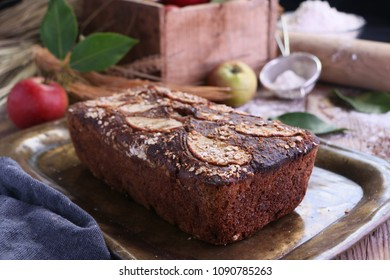 Apple Bread with fresh apple background on rustic old wooden table.