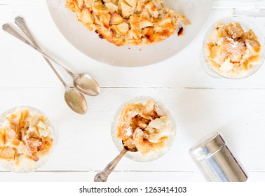 Apple bread pudding in a cup on a white background