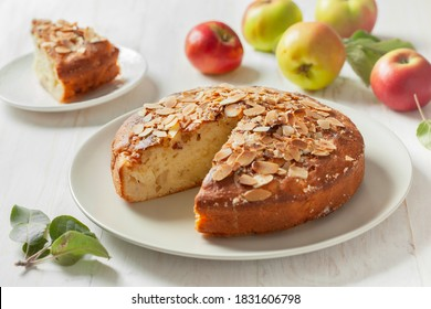 apple cake (apple apfel kuchen), fresh apples on a wooden background.