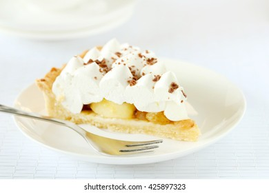 Apple cake with meringue on white plate