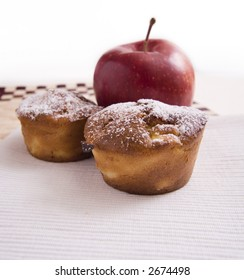 Apple cakes with red apple behind