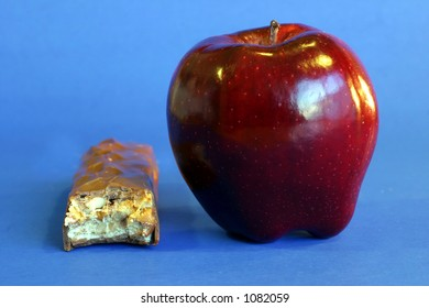 Apple and candy bar