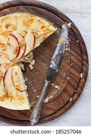 Apple cheesecake on wooden background