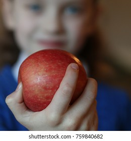 apple in child's hand