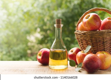 Apple cider vinegar in bottle with apple summer day
