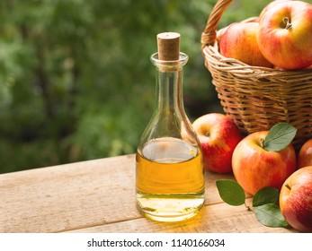 Apple cider vinegar in bottle with apple summer day