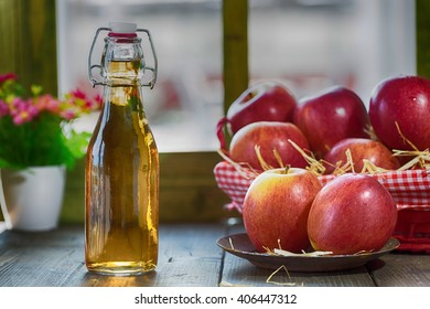 Apple cider vinegar with a fresh apple