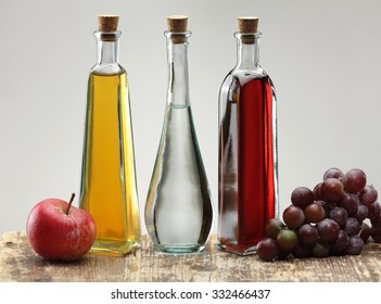 Apple cider vinegar, grapes vinegar and ordinary vinegar isolated on white background