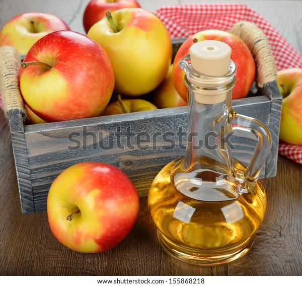 apple cider vinegar on a brown table