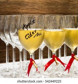 apple cider in wine glass decorate with red ribbon