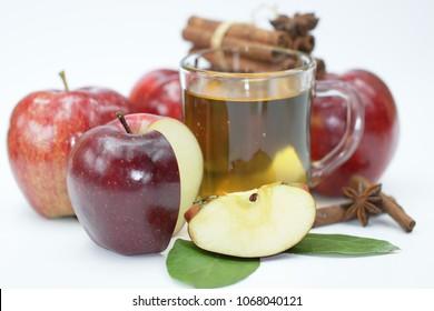 Apple, cinnamon and apple juice on white background