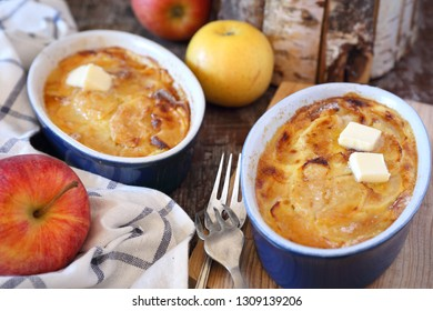 Apple clafoutis in two ceramic dish for sweet breakfast and fresh apples. Rustic style
