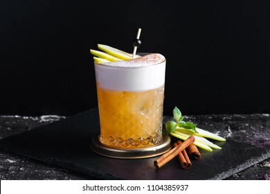 Apple cocktail with cinnamon and whipped cream