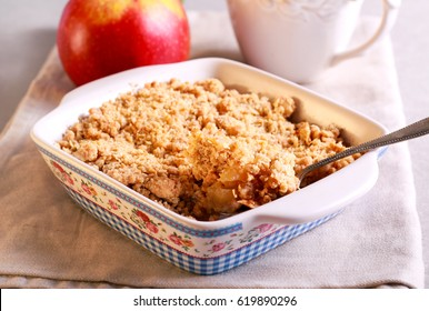 Apple crumble cake in a tin, selective focus