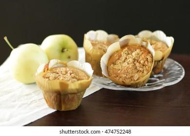 Apple crumble muffins with dark bakground