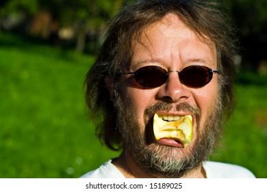 apple eating man