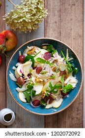 Apple and fennel salad with walnuts and greens