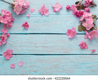apple flowers on wooden background