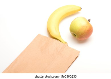 apple fruit and yellow banana with vitamin for healthy diet in paper package isolated on white background, copy space