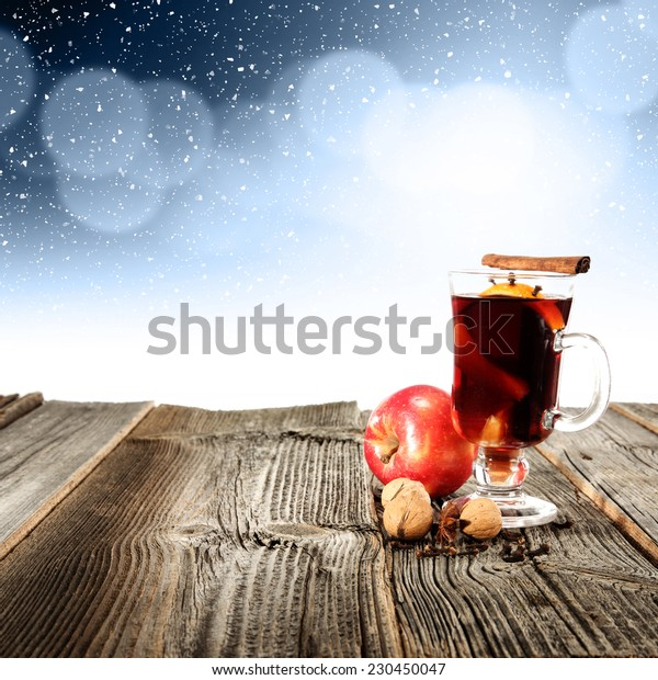 apple and glass of mulled