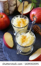 Apple granita with honey, frozen summer dessert on dark background, selective focus