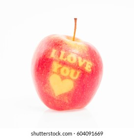 """An apple with the """"I love you"""" pattern on a white background"""