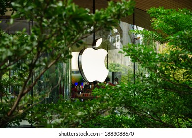 Apple Inc. Logo Neon Sign Icon at Apple Store Central World branch. Bangkok, Thailand. 27 December 2020