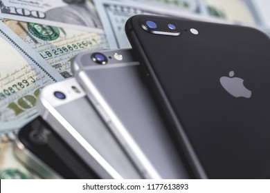 Apple iPhone devices and dollars. Ekaterinburg, Russia - September 12, 2018