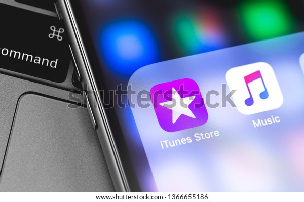 Apple iPhone with iTunes and Music icons app on the screen. Apple Music is the new iTunes-based music streaming service that arrived on iPhone. Moscow, Russia - April 9, 2019