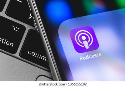 Apple iPhone with Podcasts icon app on the screen. Apple Inc. is an American multinational technology company. Moscow, Russia - April 9, 2019