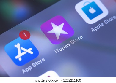 Apple iPhone with services. AppStore, iTunes, Apple Store icons on the screen. Officials services developed by Apple Inc. Moscow, Russia - October 14, 2018