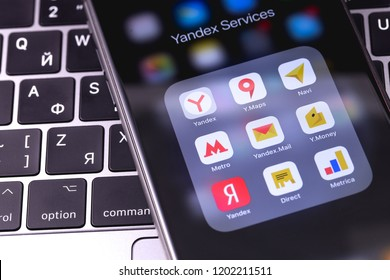 Apple iPhone with yandex services on the keyboard notebook. Yandex N.V. is a russian multinational corporation specializing in Internet-related services and products. Moscow, Russia - October 14, 2018