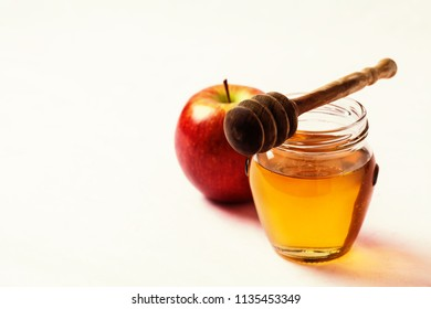 Apple and jar with honey and dipper. Rosh Hashana concept