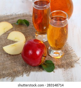 Apple juice and apples on a  wooden table