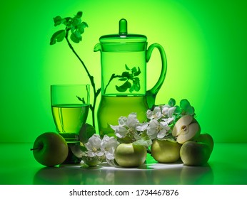 Apple juice with apple, glass and flowers
