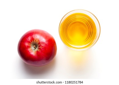 Apple juice with apple on white background