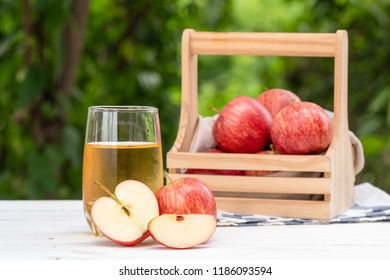 Apple juice on white table with bokeh background